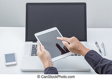 Man hand working with tablet with computer background. Technology.