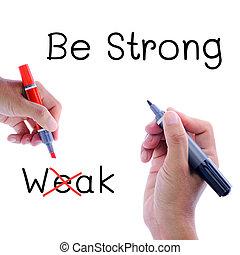 Antonym concept of strong versus weak written over tarmac