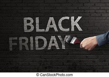 Man hand writing white Black Friday text