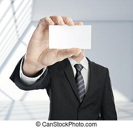 man handing blank business card