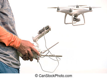 Man handle remote control of drone isolated on white background