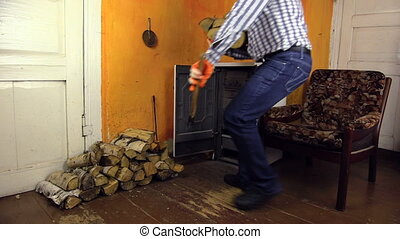 man handle wood stove