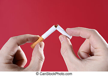 man hands breaking cigarette