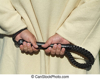 whip - man hands carry a leather whip