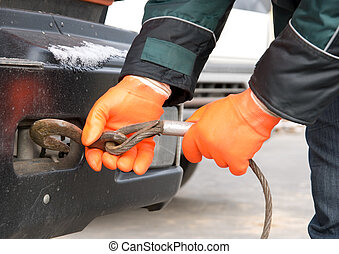 Man hands closeup with towing cable