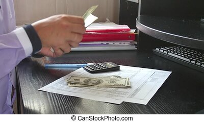 Man hands counting money cash in office. Close up of us...