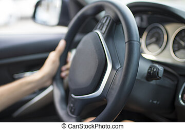 man hands driving the car