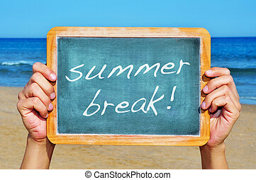 summer break - man hands holding a chalkboard on the beach ...