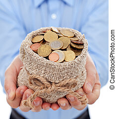 Man hands holding money bag full with euro coins - closeup