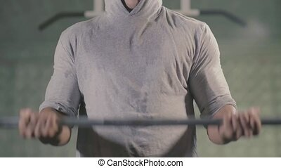 Man hands lifting weight in gym