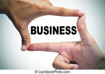 man hands making a frame with its fingers and the word business written inside