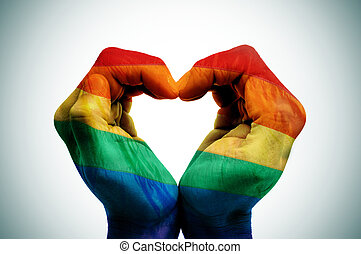 man hands patterned as the rainbow flag forming a heart, symbolizing gay love