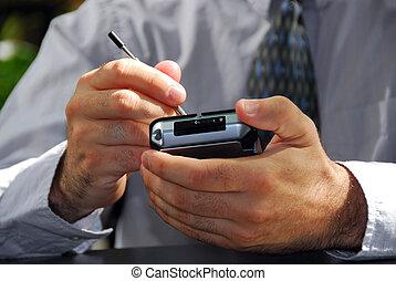Man hands pda - Businessman\\\'s hands holding pda