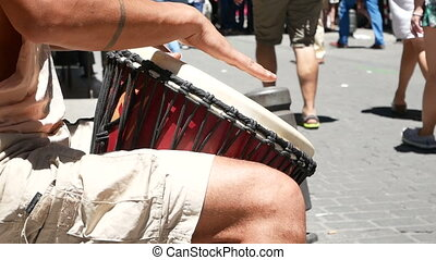 Man hands play drum - Man hands play rhythm with wooden drum...