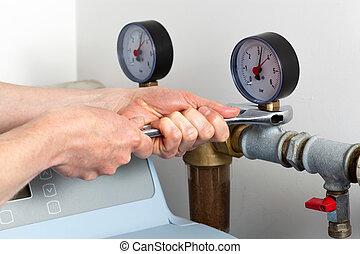 Man hands repairing pressure gauge