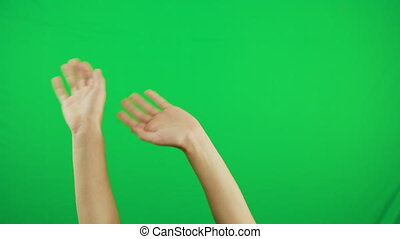 Man hands snaps their fingers over green background - man...
