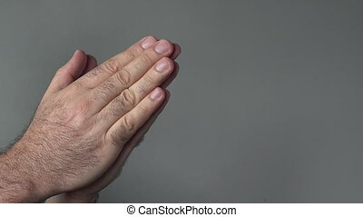 Man hands thanking on a grey background. Concepts and ideas...