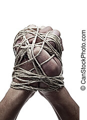 man hands tied with string, as a symbol of oppression or...