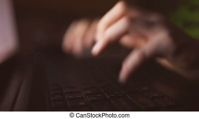 Man hands typing on a computer keyboard laptop