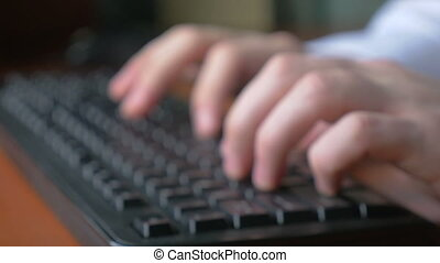 Man hands typing on a keyboard