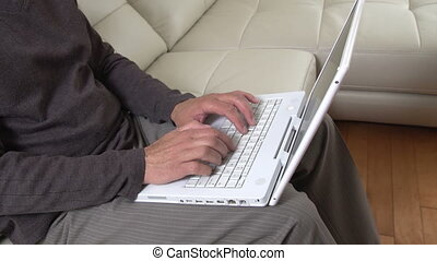 Man hands typing on laptop.