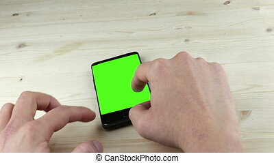 man hands using a smart phone for write text messaging with chroma key, green screen, communication with smartphone technology concept