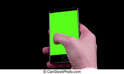 man hands using a smart phone for write text messaging with chroma key, green screen on black background, communication with smartphone technology concept