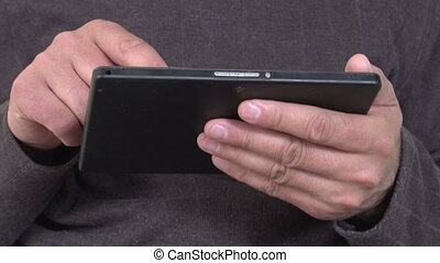 Man hands with tablet computer. Web technology.
