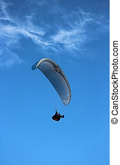 Photo taken from cliff top of hang gliders directly above~ just hanging in the air.
