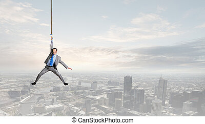 Man hang on rope