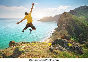 Man happines jump and sea