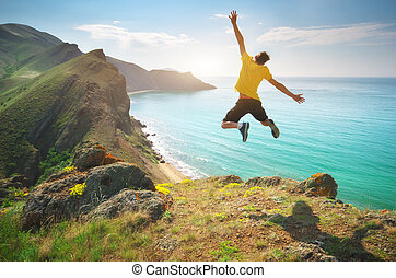 Man happines jump and sea