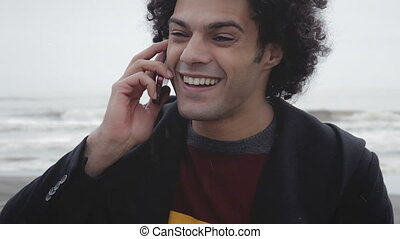 Man happy on the phone