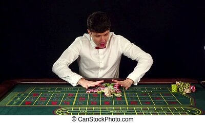 Man have lost in a casino. Black. Slow motion