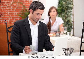 Man having a coffee in a restaurant