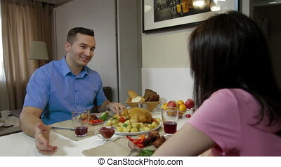 Man having a dinner together his wife