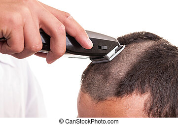 Man having a haircut with a hair clippers over a white...