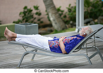 Man having a nap in the garden
