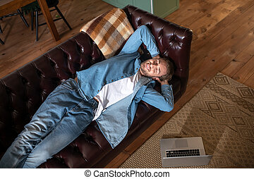 Man having a rest while working remotely at home