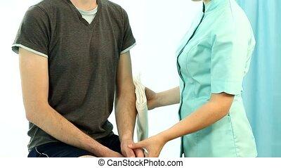 Man having arm securing