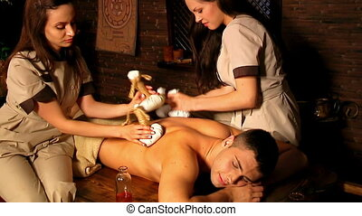 Man having Ayurvedic spa treatment. - Man having oil...