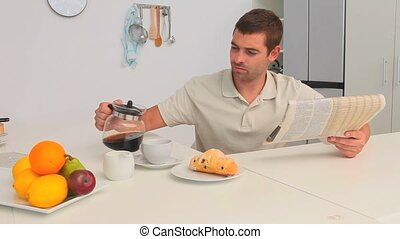 Man having breakfast in the kitchen