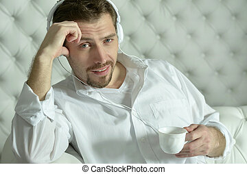 man  having coffee at home