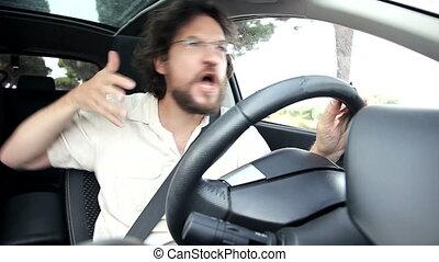 Man having fun in car dancing