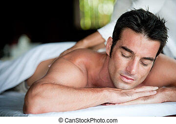 Man Having Massage - A good-looking man getting a back ...