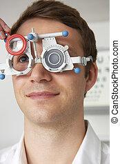 Man Having Sight Test At Optometrist
