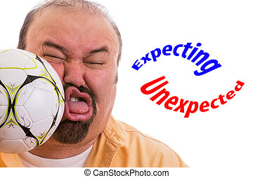 Fun picture of a middle-aged man with a goatee having the wind knocked out of him by the unexpected force of a soccer ball connecting with his face and the text expecting - unexpected, on white
