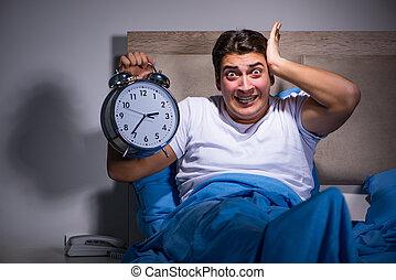 Man having trouble sleeping in bed