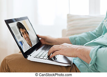 man having video call with helpline operator