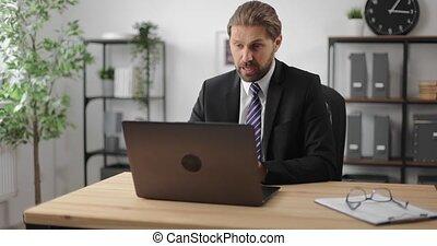 Man having video chat on laptop